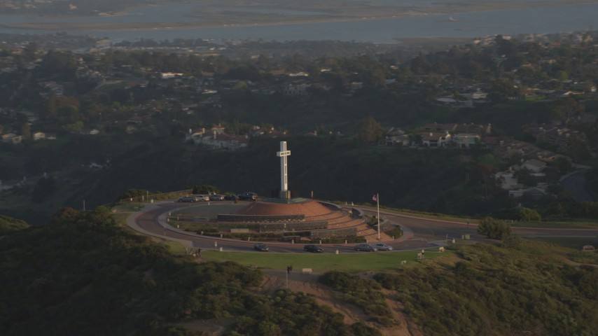 4K stock footage aerial video orbit the Soledad Cross religious monument, La Jolla, California, Sunset Aerial Stock Footage | DCA08_279
