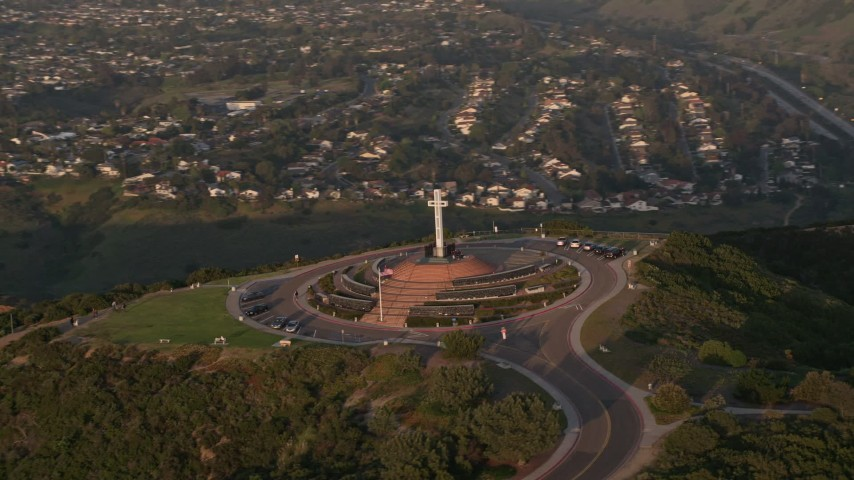 4K aerial video of flying by the Soledad Cross religious monument, La Jolla, California, Sunset Aerial Stock Footage | DCA08_280
