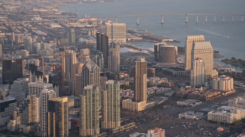 4K aerial video approach and zoom out on skyscrapers, Downtown San Diego, California, Sunset Aerial Stock Footage | DCA08_292