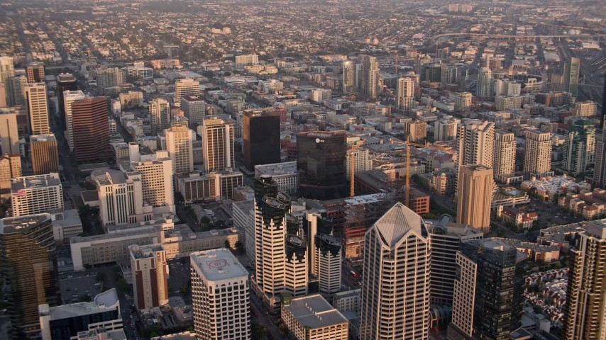 4K stock footage aerial video of panning over the city while flying over skyscrapers, Downtown San Diego, California, Sunset Aerial Stock Footage | DCA08_293
