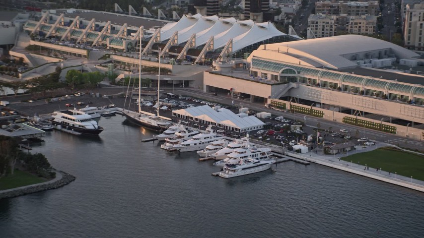 4K aerial video of yachts docked by convention center, Downtown San Diego, California, Sunset Aerial Stock Footage | DCA08_296