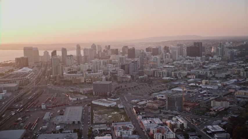 4K aerial video of panning across the city skyscrapers, and orbit Downtown San Diego, California, Sunset Aerial Stock Footage | DCA08_300