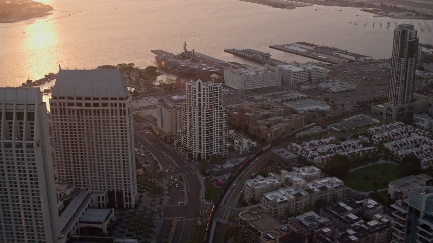 4K stock footage aerial video of flying over downtown skyscrapers to luxury hotel and marina in Downtown San Diego, California, Sunset Aerial Stock Footage | DCA08_303