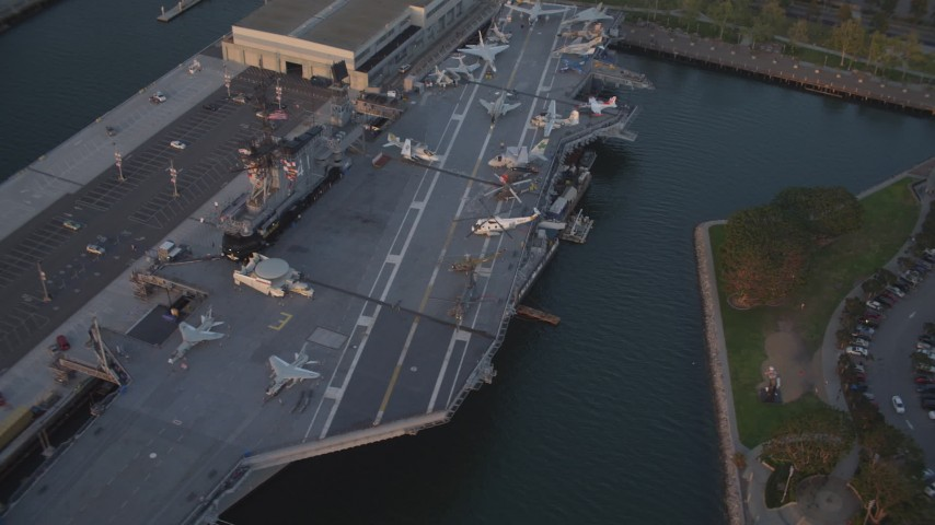 4K stock footage aerial video orbit aircraft carrier, USS Midway in Downtown San Diego, California at sunset Aerial Stock Footage | DCA08_304