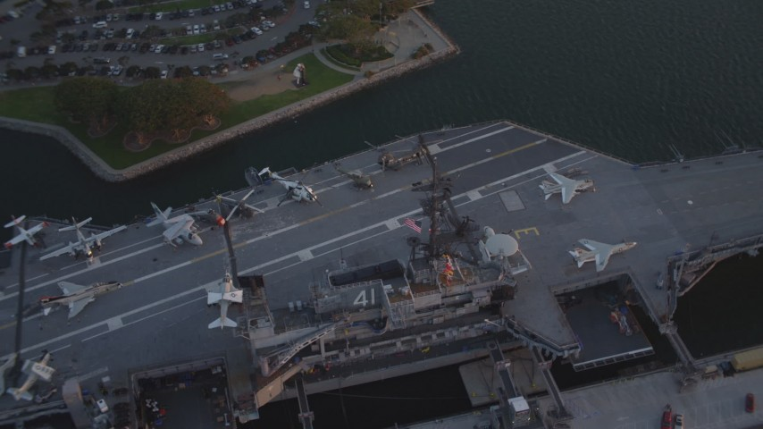 Orbit Aircraft Carrier, USS Midway Downtown San Diego California Sunset Aerial Stock Footage DCA08_305