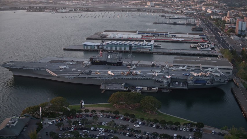 Orbit Aircraft Carrier, USS Midway Downtown San Diego California Sunset Aerial Stock Footage | DCA08_306
