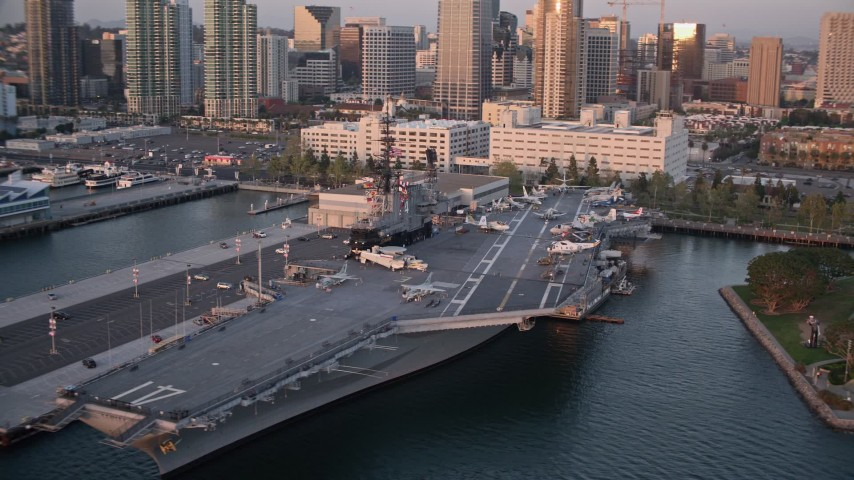 4K stock footage aerial video orbit the aircraft carrier, USS Midway, in Downtown San Diego, California, Sunset Aerial Stock Footage | DCA08_306