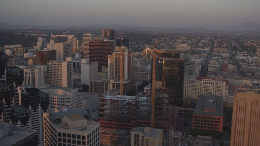 4K aerial video approach and pan across city skyscrapers, Downtown San Diego, California, Sunset Aerial Stock Footage | DCA08_308