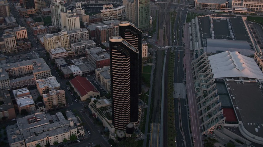 4K stock footage aerial video of a condominium skyscraper complex in Downtown San Diego, California, Sunset Aerial Stock Footage | DCA08_309