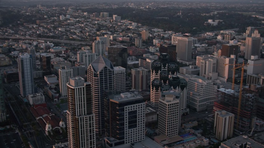 4K stock footage aerial video of panning across skyscrapers in Downtown San Diego, California, Sunset Aerial Stock Footage | DCA08_310