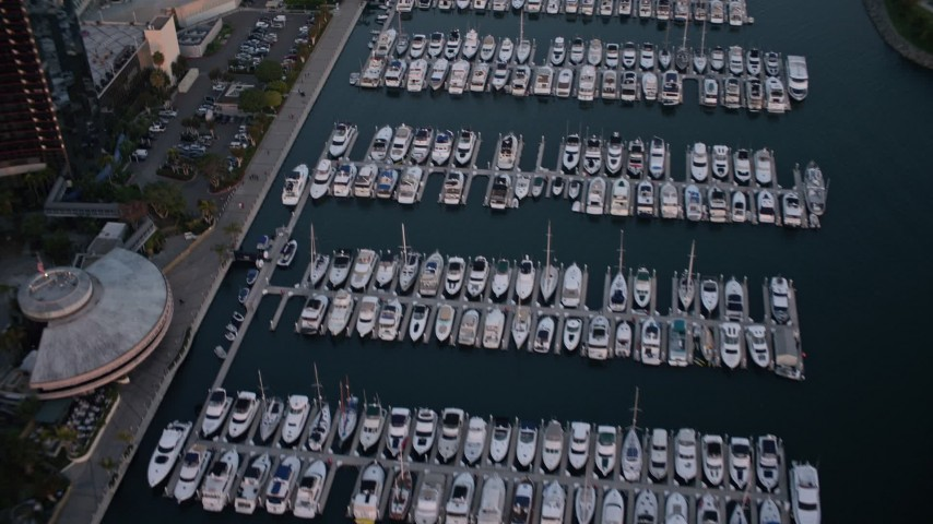 4K stock footage aerial video of a reverse view of a marina in Downtown San Diego, California, Sunset Aerial Stock Footage | DCA08_313