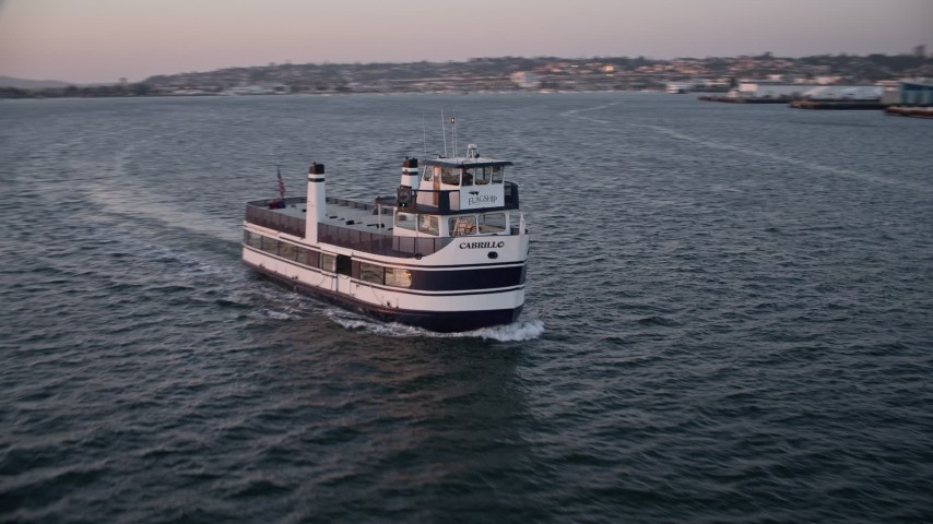 4K stock footage aerial video approach and track a ferry sailing San Diego Bay, California, Sunset Aerial Stock Footage | DCA08_314