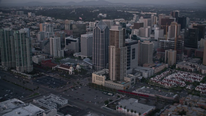 4K aerial video of panning past city skyscrapers and streets in Downtown San Diego, California, Sunset Aerial Stock Footage | DCA08_322