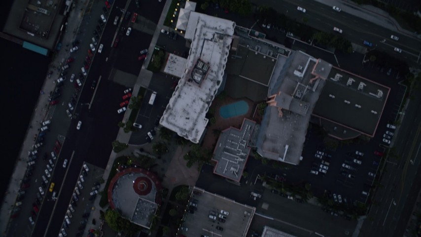 4K aerial video of a bird's eye view of city streets and buildings in Downtown San Diego, California, Sunset Aerial Stock Footage | DCA08_326