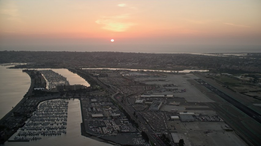 4K stock footage aerial video of the setting sun over San Diego International Airport, California Aerial Stock Footage | DCA08_327