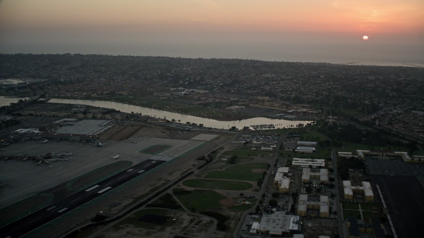 4K stock footage aerial video of an airplane taking off from San Diego International Airport, California, Sunset Aerial Stock Footage DCA08_328 | Axiom Images