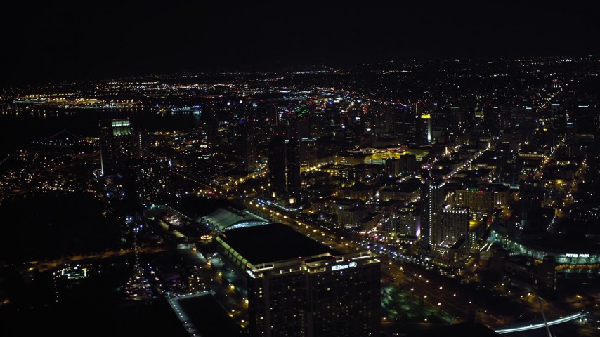 4K aerial video of skyscrapers, hotels, convention center and stadium in Downtown San Diego, California, at night Aerial Stock Footage DCA08_344