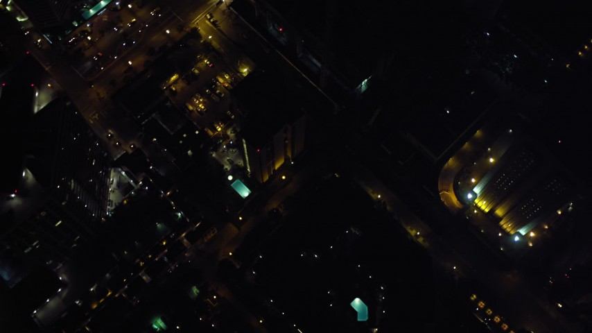 4K aerial video of a bird's eye of city streets and skyscrapers, Downtown San Diego, California, Night Aerial Stock Footage | DCA08_348