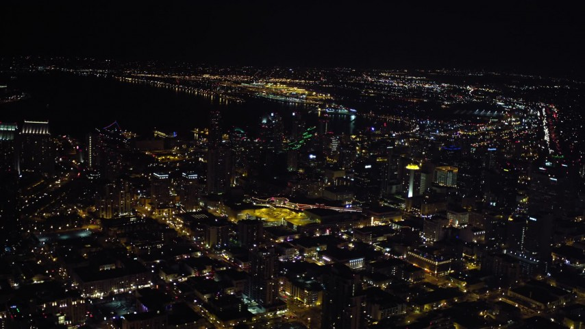 4K stock footage aerial video of tilting from city buildings to skyscrapers, Downtown San Diego, California, Night Aerial Stock Footage | DCA08_359