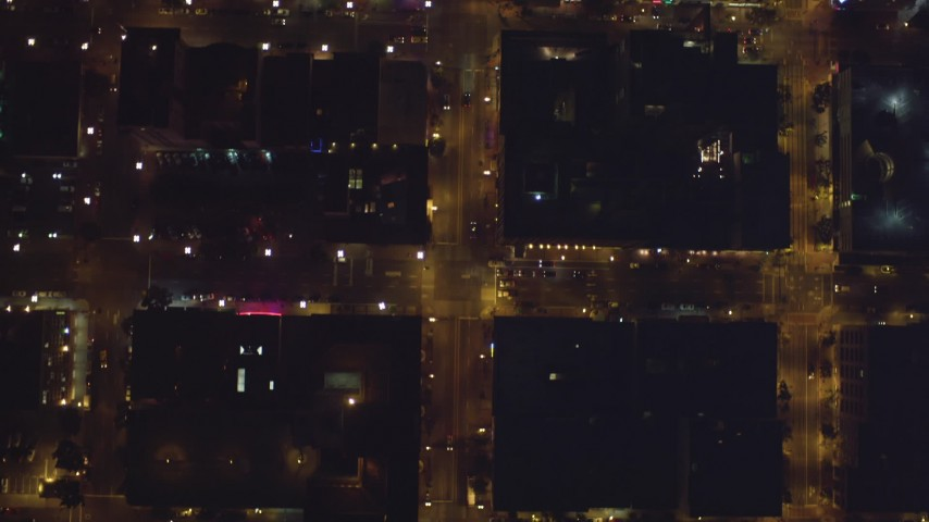 4K stock footage aerial video of a bird's eye view of city streets, reveal skyscrapers in Downtown San Diego, California, Night Aerial Stock Footage | DCA08_361