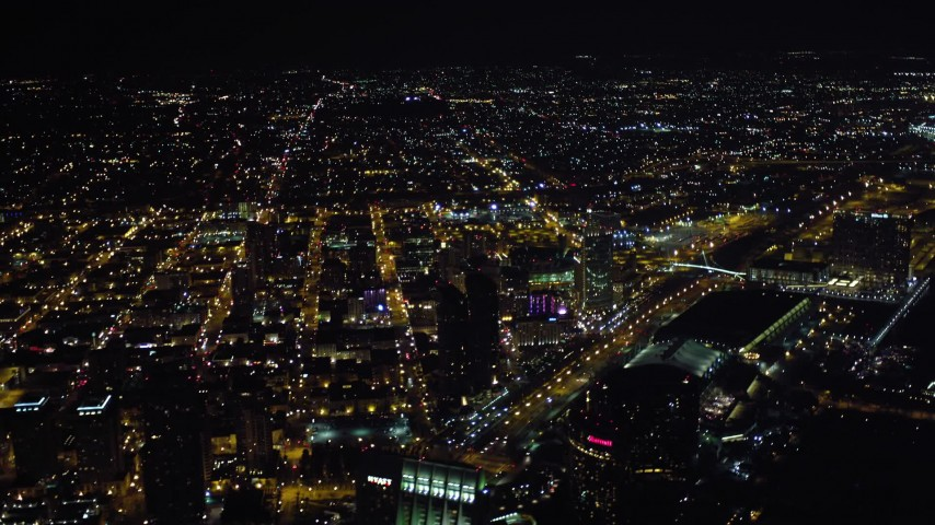 4K aerial video tilt to reveal luxury hotels, skyscrapers, and city sprawl, Downtown San Diego, California, Night Aerial Stock Footage | DCA08_363