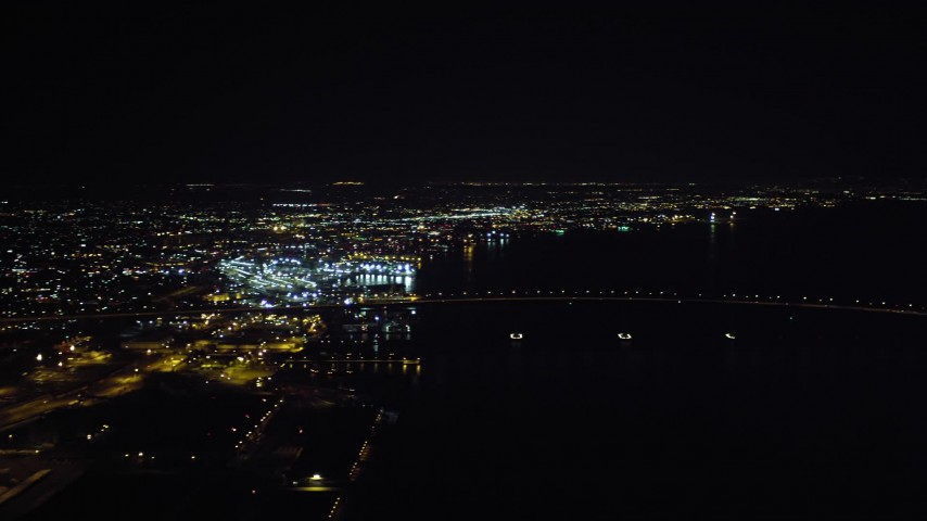 4K aerial video of panning across downtown to reveal the Coronado Bridge and San Diego Bay, California, Night Aerial Stock Footage | DCA08_364