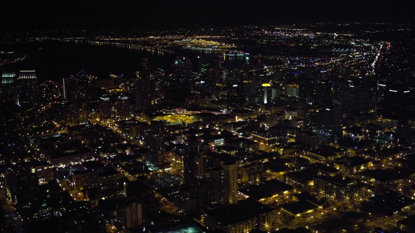 4K aerial video of flying by city skyscrapers in Downtown San Diego, California at night Aerial Stock Footage | DCA08_367