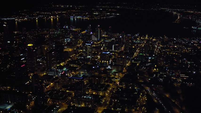 4K aerial video of flying by city skyscrapers in Downtown San Diego, California, Night Aerial Stock Footage | DCA08_369