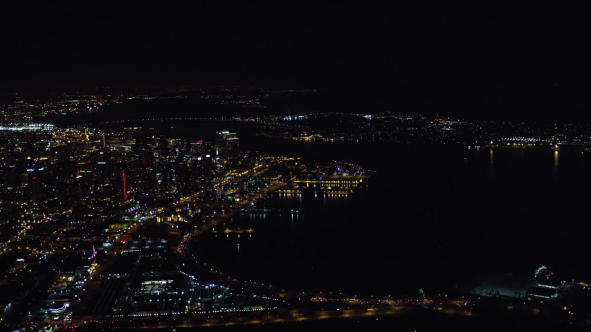 4K aerial video of flying by skyscrapers and part of the bay, Downtown San Diego, California, Night Aerial Stock Footage | DCA08_373