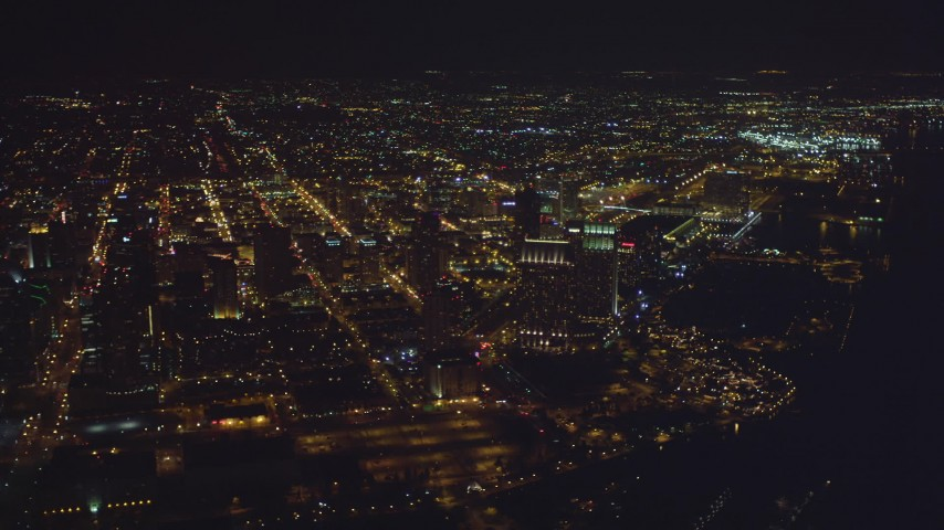 4K aerial stock footage video of panning from luxury hotels to skyscrapers at night in Downtown San Diego, California Aerial Stock Footage | DCA08_375