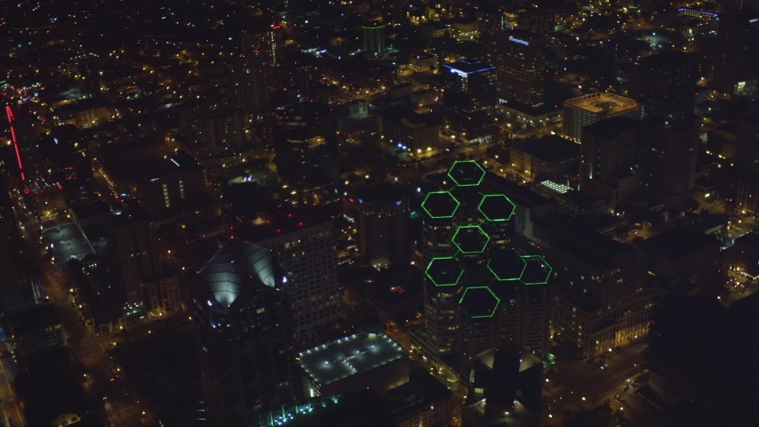 4K aerial stock footage video approach and tilt to the tops of skyscrapers, Downtown San Diego, California, Night Aerial Stock Footage | DCA08_376
