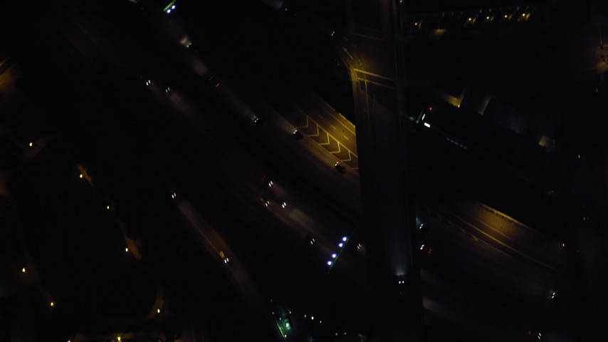 4K aerial video of a bird's eye of city streets and skyscrapers, reveal the freeway, Downtown San Diego, California, Night Aerial Stock Footage | DCA08_377