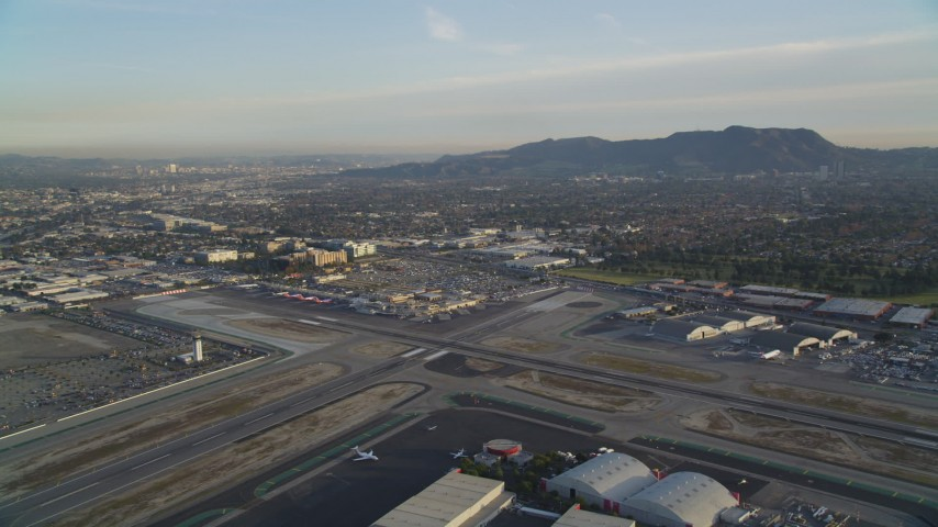 5K stock footage aerial video approach runways and terminals at Burbank Airport at sunset, California Aerial Stock Footage | DCLA_001