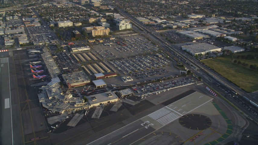 5K stock footage aerial video of terminals and parking lots at the Burbank Airport at sunset, California Aerial Stock Footage | DCLA_003