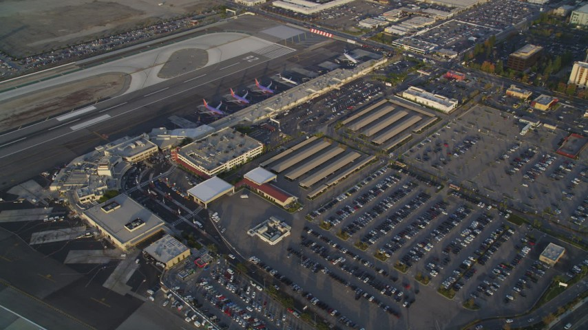 5K stock footage aerial video orbit main terminals and parking lots at sunset at Burbank Airport, California Aerial Stock Footage | DCLA_004