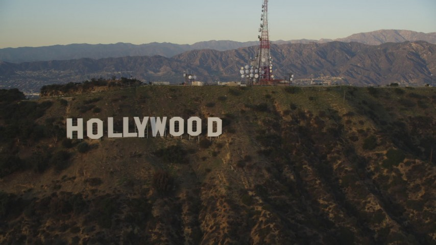 5K stock footage aerial video flyby the Hollywood Hills to reveal the Hollywood Sign at sunset, California Aerial Stock Footage | DCLA_006