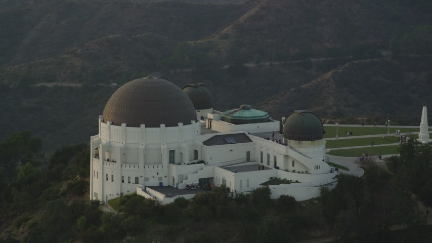 5K stock footage aerial video orbit east side of the Griffith Observatory at sunset, California Aerial Stock Footage | DCLA_009