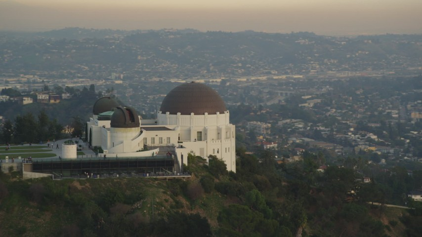 5K stock footage aerial video flyby the west side of the Griffith Observatory at sunset, California Aerial Stock Footage | DCLA_010