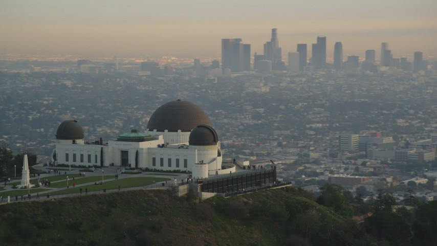 Orbit Griffith Observatory to Reveal Downtown Los Angeles Skyline at Sunset Aerial Stock Footage | DCLA_011