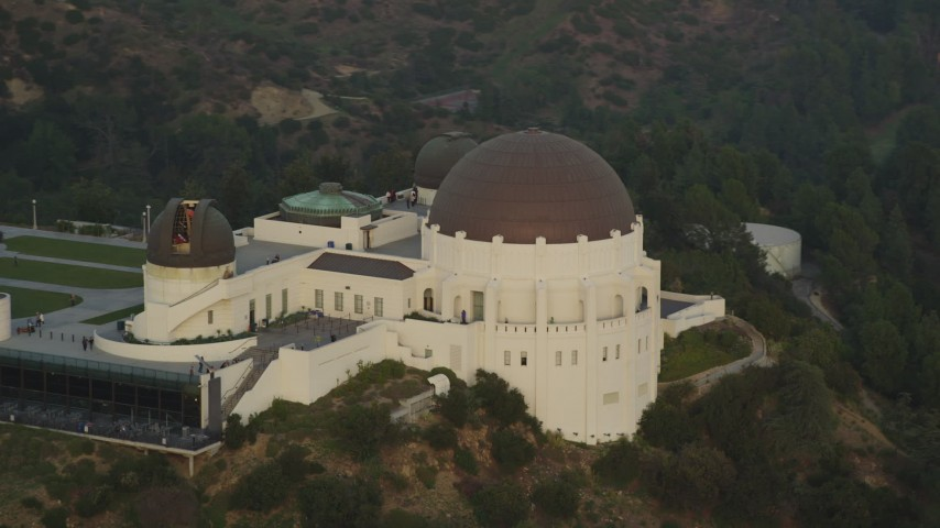 5K stock footage aerial video orbit west side and front of the Griffith Observatory at sunset, California Aerial Stock Footage | DCLA_012