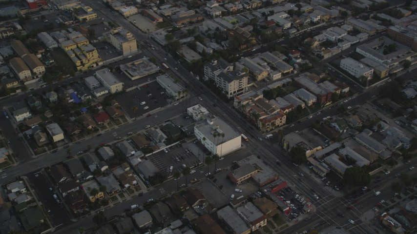 5K stock footage aerial video tilt from Downtown Los Angeles skyline to Beverly Boulevard through Hollywood at sunset, California Aerial Stock Footage | DCLA_014