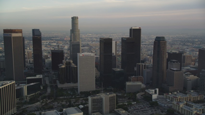 5K stock footage aerial video tilt from city streets in Westlake to reveal and approach Downtown Los Angeles at sunset, California Aerial Stock Footage | DCLA_016