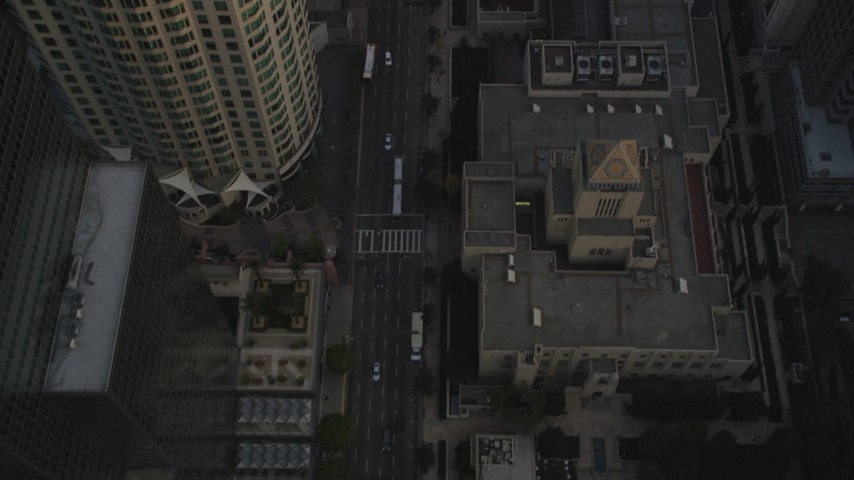 Fly Over Skyscrapers and Tilt to Reveal 5th Street and the Los Angeles Public Library at Sunset Aerial Stock Footage | DCLA_017
