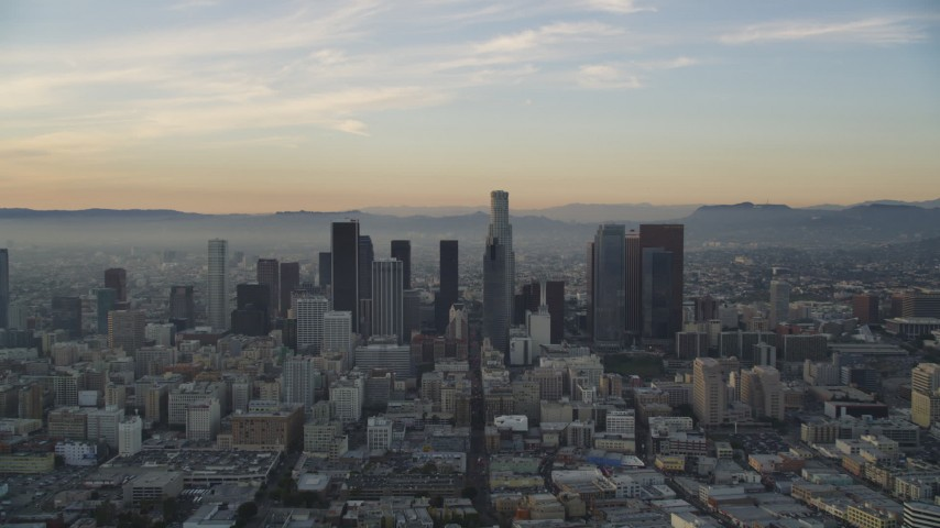 5K stock footage aerial video of Downtown Los Angeles seen from south of the city at sunset, California Aerial Stock Footage | DCLA_018