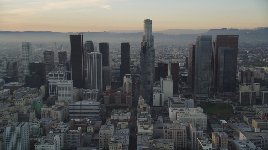 Tilt from 5th Street to Reveal and Approach Downtown Los Angeles Skyscrapers at Sunset Aerial Stock Footage | DCLA_019