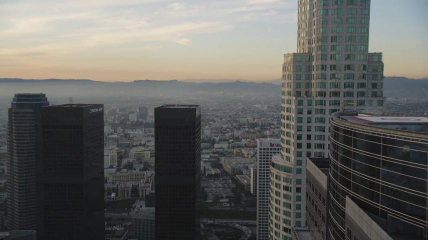 5K stock footage aerial video flyby Gas Company Tower and US Bank Tower in Downtown Los Angeles at sunset, California Aerial Stock Footage | DCLA_021