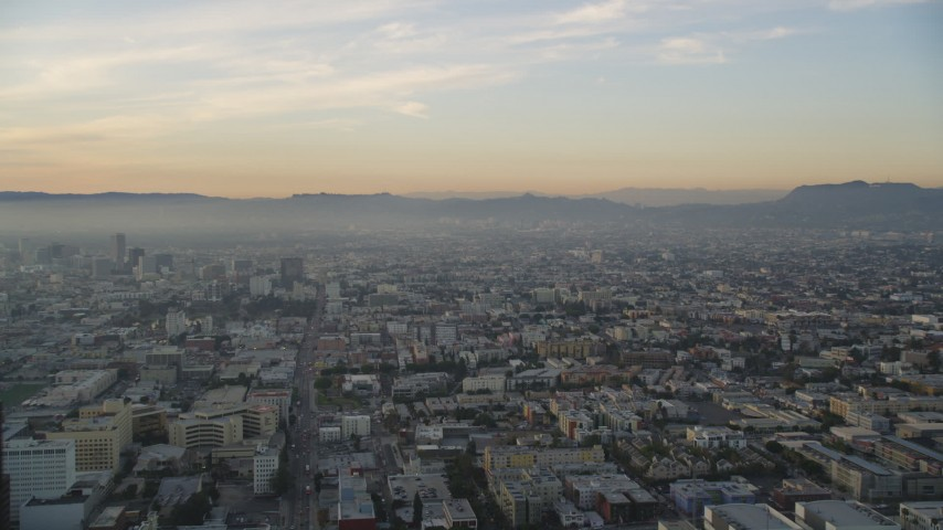 Approach Hollywood from Downtown Los Angeles, California at Sunset Aerial Stock Footage | DCLA_022