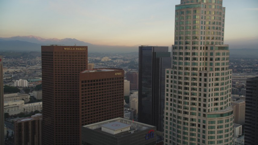 5K stock footage aerial video fly over and approach tower at sunset in Downtown Los Angeles, California Aerial Stock Footage | DCLA_027