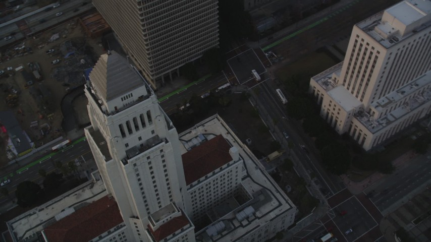 5K stock footage aerial video approach Los Angeles City Hall at sunset in Downtown Los Angeles, California Aerial Stock Footage | DCLA_029