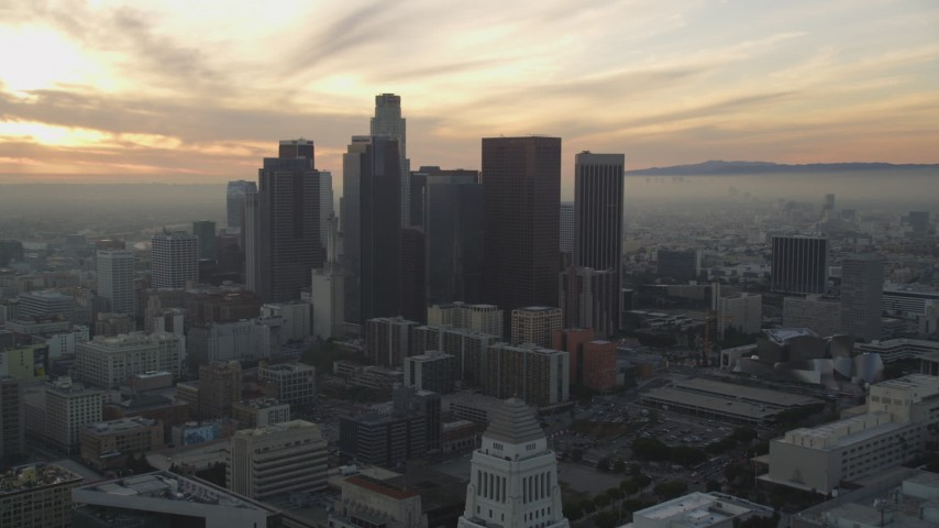 5K stock footage aerial video tilt from City Hall to reveal skyline at sunset in Downtown Los Angeles, California Aerial Stock Footage | DCLA_030
